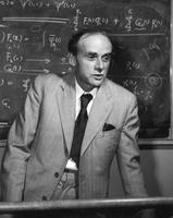 Paul Dirac Lecturing in front of chalkboard, Ottawa