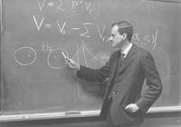 Paul Dirac lecturing at blackboard, Iowa City, Iowa