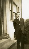Paul Dirac standing in front of house