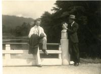 Werner Heisenberg sits on a bridge with unknown man