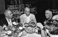 Paul Dirac and Petr Kapitza at table with others