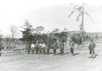 Young men standing in a line