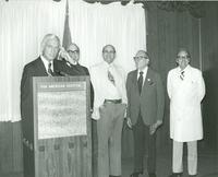 Claude Pepper standing with a group of men at the Pan American Hospital