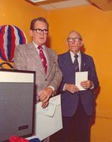 Claude Pepper and an unidentified man speaking at a function for senior citizens