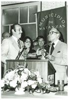 Claude Pepper accepting a plaque in front of a Municipio De Matanzas banner