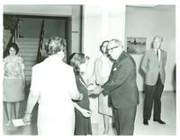 Claude Pepper shaking the hand of a young girl