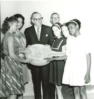 Claude Pepper presenting the Great Seal of the United States to a group of blind students