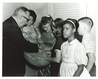 Claude Pepper and a group of blind students with the Great Seal of the United States