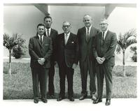 Claude Pepper posing with staff of Hialeah Junior High School