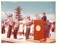Claude Pepper presenting an American flag at a park dedication on Veterans' Day