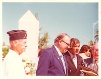 Claude Pepper and others presenting a plaque at a park dedication on Veterans' Day