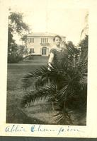 Abbie Champion standing in front of house