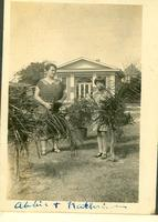 Abbie Champion and Katherine Webster standing behind bushes