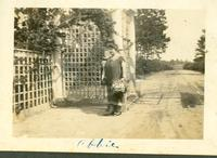 Abbie Champion and child at the Highland Park gate