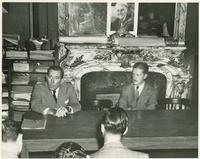 Claude Pepper addressing journalists during a press conference