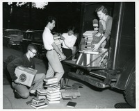 Students Loading Books on a Truck