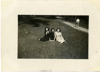 "Mary Tarver, Carol Parky, and ""Jartha"" Sitting on the Grass"