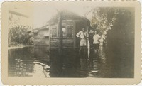 Mary Tarver and an Unidentified Man Standing in Flooded Area