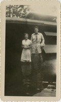 Man and Woman Standing in a Flooded Area