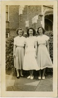 Faye Johns, Mary Tarver, and Va. Riley Outside Campus Building