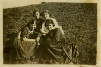 Four Women Sitting on the Ground