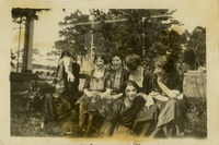 Seven Women Sitting Outdoors