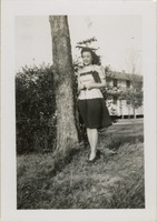 Woman Standing Next to a Tree