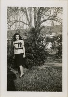Woman Standing Next to Shrub