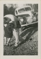 Man and Woman in Front of Ford Automobile