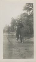 Man and Woman on a Dirt Road in the Woods