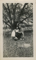 Giles O. Lofton, Anicia Aleman Lofton, and a Man at a Picnic Table in the Woods