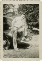 Giles O. Lofton with his Foot on the Bumper of an Automobile
