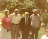 A small group standing in a garden