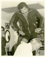 Burt Reynolds Having His Knees Taped by Don Fauls