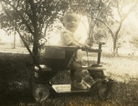 Baby In A Toy Tractor