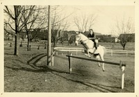 Horse and Riding Student Jumping Over Fence at Trot-A-Way Stables