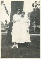 Effie Rolfs and Olga M. Kent Standing Near a Tree
