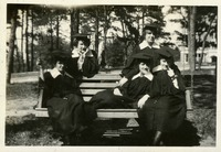 Alice D, Marion Stine, Olga M. Kent, Alice Mosier, and Clara Opsahl Posing on a Swing