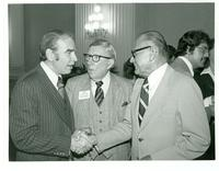 Texas Representative Jim Wright shaking hands with Jim Brennan
