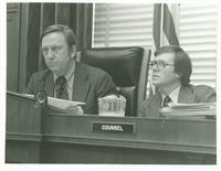 Counsel sitting at a bench at a House Aging Committee hearing