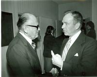 Two men talking at the reception for Mildred Pepper's memorial service