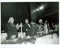 Bob Hope standing at a podium at Claude Pepper's 84th birthday party