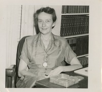 Unidentified Woman Sitting at a Desk