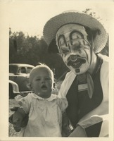 Circus Clown Posing With Baby