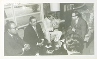 Lawton Chiles with a Group of Men Chatting over Drinks