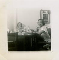 Two Women Sitting at a Table Having a Meal