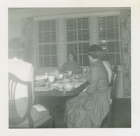 Four Women at the Dining Table in the Home Management House