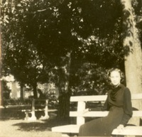 Florence Gregory Sitting on a Bench by a Tree