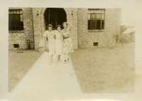 Florence Gregory and Two Other Women Outside a Brick Building