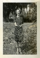 Florence Gregory Standing Near a Shrub